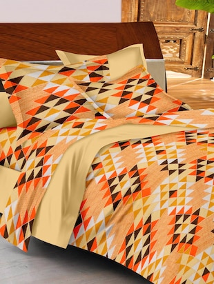 beige- orange- brown colored, cotton double bedsheet with 2 pillow covers