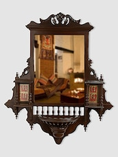 "ExclusiveLane Teak Wood ""Maharaja"" Wall Mirror With Dhokra Work In Walnut Brown - By"