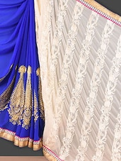 Cream And Royal Blue Embroidered Georgette Saree - Style Mania