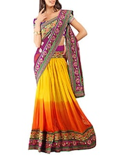 yellow, orange net embroidered  saree  available at Limeroad for Rs.5991