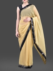 Beige Georgette Saree With Sequined Border - Purple Oyster