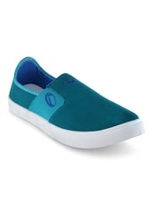 blue canvas slip on shoe  available at Limeroad for Rs.499