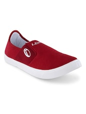 red canvas slip on shoe  available at Limeroad for Rs.499