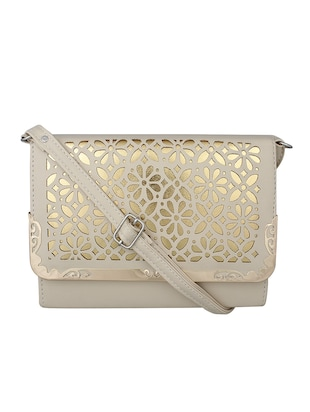 beige leatherette sling bag