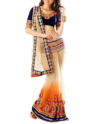 beige net embroidered lehenga saree