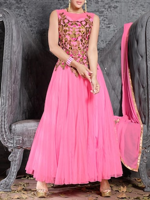 Pink embroidered sleeveless silk net and georgette salwar suit set