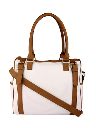 white and brown leatherette handbag