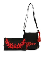 Set Of Embroidered Wristlet And Black Sling Bag - By