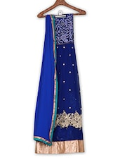 Blue Zari Embroidered Semi Stitched Net Suit Set - By