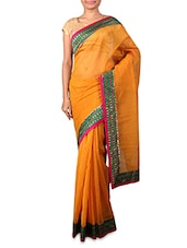 Yellow Supernet Saree With Patterned Border - INDI WARDROBE