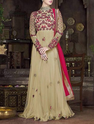 beige embroidered net semi-stitched suit set
