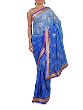 Shaded Blue Printed Saree With Gold Border - By