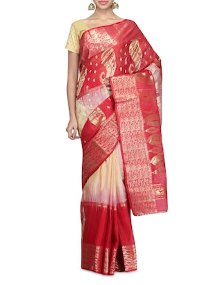 Beige and red printed tussar silk sari