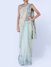 Ice Blue And Cream Embellished Net Saree - By