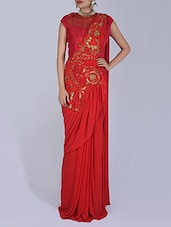Solid Red Embroidered Net Sari - By