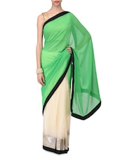 Spring Green Poly Georgette And Beige Net Sequined Saree - By