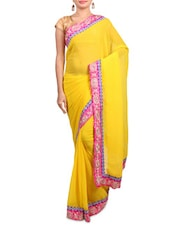 yellow embroidered georgette saree available at Limeroad for Rs.2750