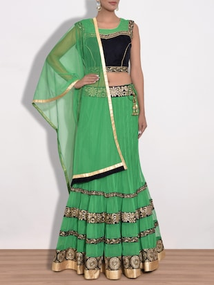 green embroidered net lehnga set