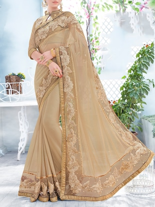beige synthetic embroidered saree