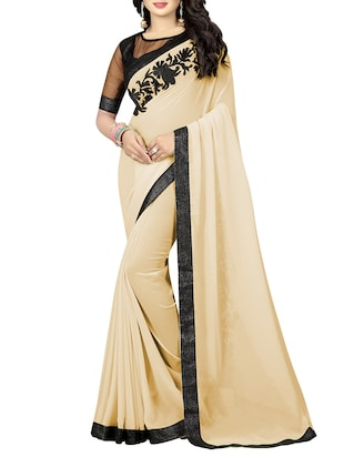 beige georgette embroidered saree