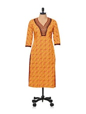 Orange Printed Kurti With Embroidered Neckline - AFSANA