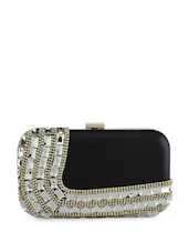 Black box clutch with heavy embellishments