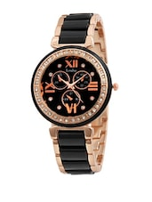 Black and golden wrist watch with a stone studded dial -  online shopping for watches
