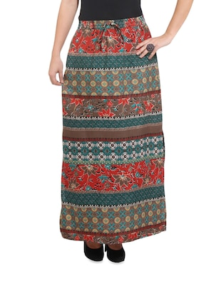 Trendy multi-coloured printed long skirt with a side slit