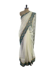 Elegant White Saree With Stunning Green Saree - Pothys