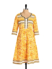 Striking Yellow Printed Cotton Flared Kurta - Aaboli