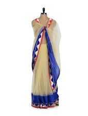Remarkable Beige Net Saree With Gorgeous Blue Border - Purple Oyster