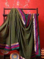 Green Georgette Saree With Colorful Zari Border - RiniSeal