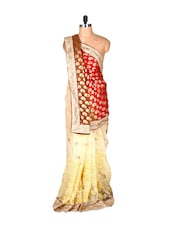 Cream, Rust And Red Jacquard And Net Saree With Prints And Tread Work, With A Matching Blouse Piece - Saraswati