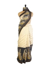 Beautiful Beige And Black Super Net Saree With Resham Embroidery, Patch Border And Black Blouse - Drape Ethnic