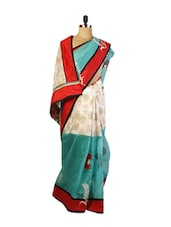 Smart Blue And Off-White Coloured Super Net Saree With Resham Embroidery, Aplique, Patch Border And A Matching Red Blouse. - Drape Ethnic