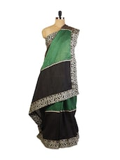 Beautiful Green And Black  Festive Wear Art Silk Saree With Zari Embroidered Border, Stone Work And Patch Border, Black Art Silk - Drape Ethnic