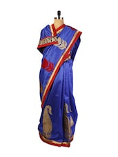 Beautiful Blue Art Silk Saree With Aplique, Zari Embroidered And Patch Border, A Matching Red Blouse. - Drape Ethnic