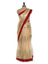 Gorgeous cream sequined saree with red border