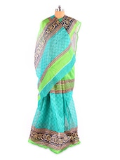 Elegant Green Printed Bhagalpuri Silk Saree With Blouse Piece - Riti Riwaz