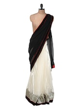 Black And Gold Net Saree With A Sequined Border - Purple Oyster