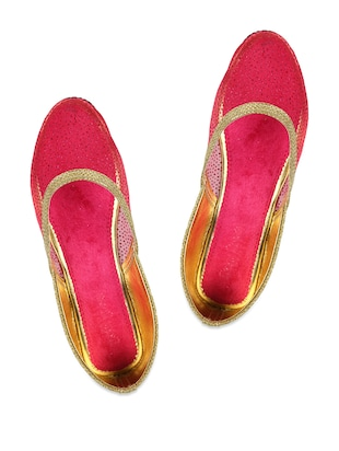 Pink and gold ballerinas