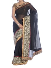 Solid Black Saree With Gold Floral Border - Suchi Fashion