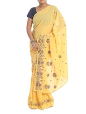 Floral Trimmed Yellow Georgette Saree - Saraswati