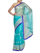 Aqua Blue Embroidered Net Saree - Aakriti
