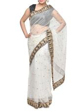 Stunning White Net Saree With Embroidery - Aakriti