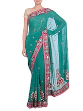 green embellished and embroidered georgette saree available at Limeroad for Rs.2750