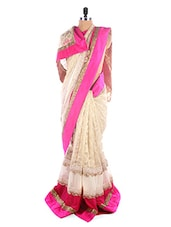 Gold Trim Luxe Beige Saree With Pink Border - SEEPIA
