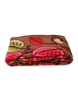 multicolored floral and leaf printed blanket