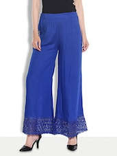 Solid Royal Blue Rayon Palazzos With Laced Hem - By