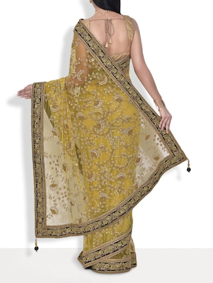 Yellow embroidered net handworked saree